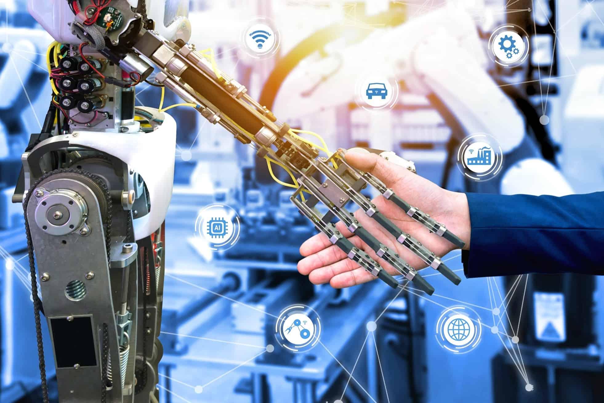 setor para investir indústria 4.0: mão humana cumprimenta robô